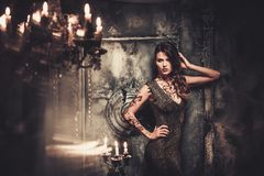Woman in spooky interior. Tattooed beautiful woman in old spooky interior stock photos