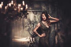 Woman in spooky interior Stock Photos