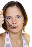 Woman with spoon Stock Images