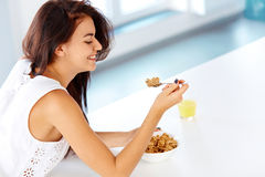 Woman with a spoon and a bowl of cereal looking down Royalty Free Stock Photo
