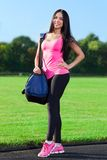 Woman sport bag on stadium outdoors training Stock Image