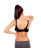 Woman in sport clothes with back pain. Isolated on white background stock images