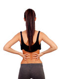 Woman in sport clothes with back pain. Isolated on white background royalty free stock photography
