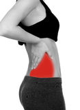 Woman in sport clothes with back pain. Isolated on white background stock photo