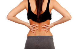 Woman in sport clothes with back pain Royalty Free Stock Photo