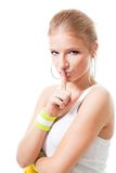 Woman in sport clothes make shh sign Royalty Free Stock Image