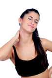 Woman in sport clothes with neck pain. Isolated on white background royalty free stock photo