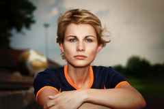 Woman in sport dress looking at camera - outdoor portrait Stock Images