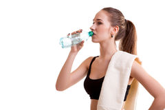 Woman after sport drinking water from bottle Stock Image
