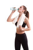 Woman after sport drinking water from bottle Royalty Free Stock Images