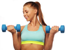 Woman in sport equipment practice with hand weights Royalty Free Stock Photography
