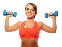 Woman in sport equipment practice with hand weights Royalty Free Stock Photo