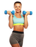 Woman in sport equipment practice with hand weights Royalty Free Stock Photos