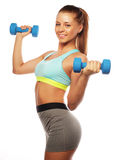 Woman in sport equipment practice with hand weights Stock Images