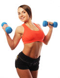 Woman in sport equipment practice with hand weights Stock Photo