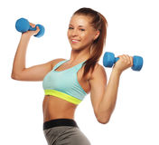 Woman in sport equipment practice with hand weights Stock Image