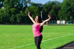 Woman sport excited raised arms up Royalty Free Stock Images