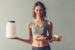 Woman with sport nutrition royalty free stock photos