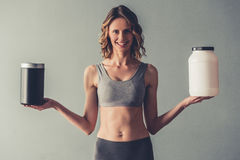 Woman with sport nutrition stock photo