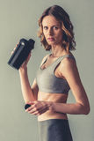 Woman with sport nutrition stock photography