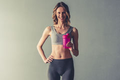 Woman with sport nutrition Royalty Free Stock Image