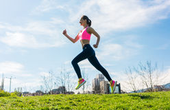 Woman sport running on hill for fitness Royalty Free Stock Image