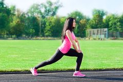 Woman sport on stadium summer outdoors training Royalty Free Stock Image