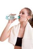 Woman in sport wear drinking water Royalty Free Stock Photo