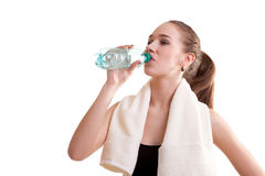 Woman in sport wear drinking water Royalty Free Stock Photos