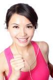 Woman in sport wear listening music Stock Photos