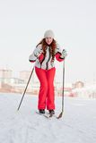 Woman in a sporting suit on skis Stock Images