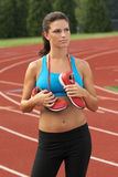 Woman in Sports Bra with Running Shoes Around Her Neck Stock Photos