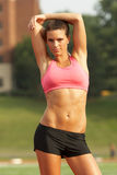 Woman in Sports Bra Stretching Stock Photo