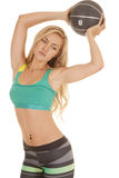 Woman sports bra stripe pants ball hold up Stock Photo