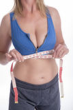 Woman in sports bra with tape measure Stock Image