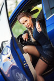 Woman in a sports car Stock Photography
