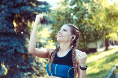 Woman at sports cheerful pumping fists smiling royalty free stock image