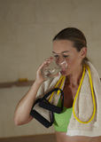Woman in sports clothing drinking water Stock Image