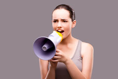 The woman in sports concept with loudspeaker Stock Photo