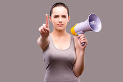 The woman in sports concept with loudspeaker Stock Photos