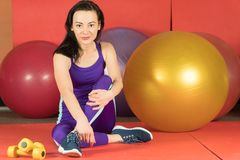 Woman sports exercises. Fitball. bright tracksuit stock images