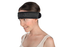Woman with a sports headband. Sport's beauty - close-up of a woman after workout wearing medical sport hair band isolated on white background Royalty Free Stock Photos
