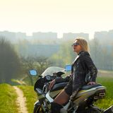 Woman on a sports motorcycle. Portrait of a beautiful blonde woman on a sports motorcycle Stock Photo