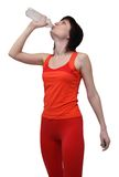 Woman in sports outfit drinking water Stock Images