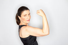 Woman sports outfit showing muscles Royalty Free Stock Images
