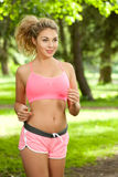 Woman sports, running in the park Stock Photo