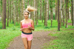 Woman sports, running in the park Stock Images