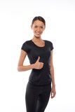 Woman in sports wear gesturing, isolated on white Royalty Free Stock Image
