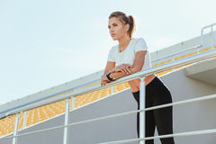 Woman in sports wear standing at stadium Royalty Free Stock Image