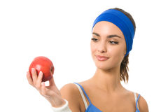 Woman in sportswear with apple Stock Photos